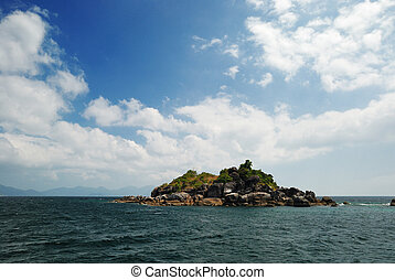 Small island under blue sky