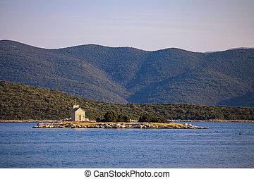 Small island with church in Adriatic sea