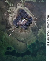 Small island with house near Seven Mile Bridge in Florida, USA
