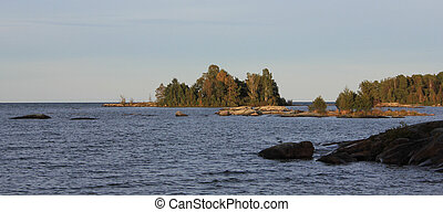 Small islands covered by trees in Vita Sannar.