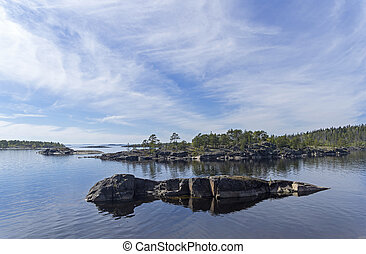 Small islands in the Ladoga skerries, Karelia, Russia. Sunny...