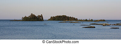 Small islands near the shore of Lake Vanern on a summer afternoon.