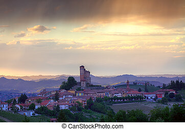 Small italian town on the hills at sunset.