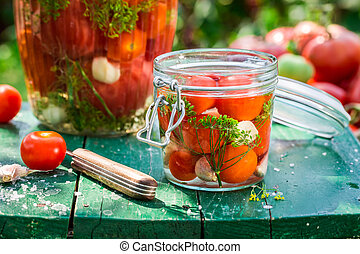 Small jar of tomatoes during preserving