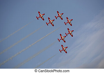 small jets fluying in formation at an airshow in canada