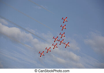 airshow - small jets fluying in formation at an airshow in...