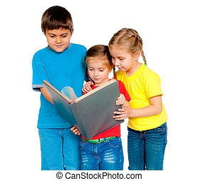 small kids with a book