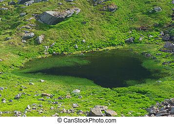 Small lake on the island of Moskenesoya, Lofoten, Norway