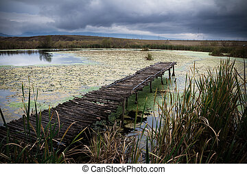 Small lake with pier