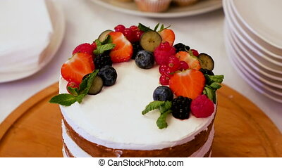 small layer cake with different fruits