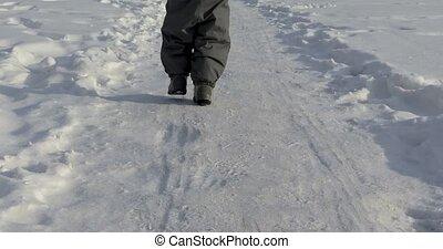 Small legs child run snowy road - Small legs child run road...
