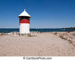 Small Lighthouse by the sea shore