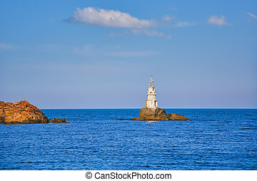 Small Lighthouse in the Sea