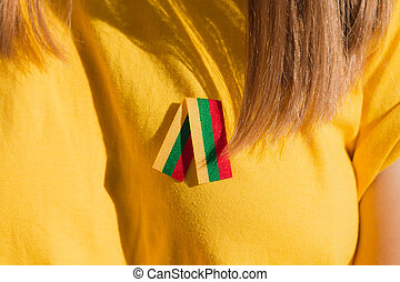Small lithuanian flag ribbon on woman chest