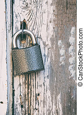 Small lock on an old wooden door