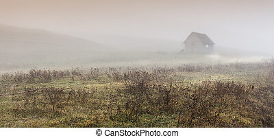 Small lonely provincial house on a foggy morning near Sic...