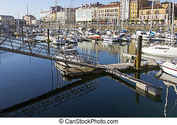 small marina with calm sea in the city of Gijon, Spain