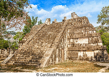 Small mayan pyramid in the forest, Chichen Itza...