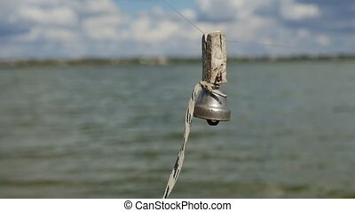 Small metallic ring attached to a fishing rod waving in the...