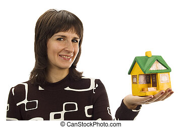 small model house on a female hand