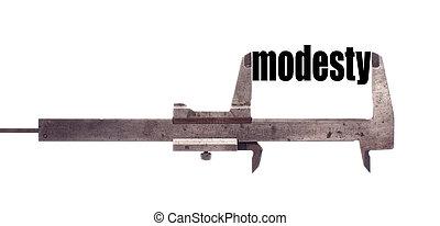 Small modesty concept - Color horizontal shot of a caliper...