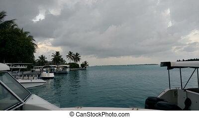 Small motor boats anchored on the pier. Maldives.4K