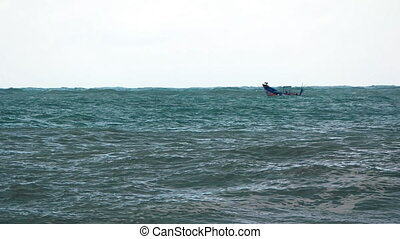 Small Motorized Fishing Boat Braves Rough Seas in Vietnam, with Sound