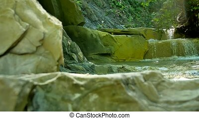small mountain river with rocks. River in nature the mountains wildlife beautiful landscape