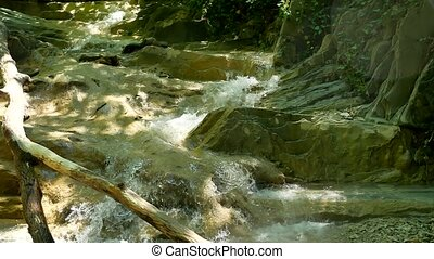 small mountain river with rocks. River in the mountains...