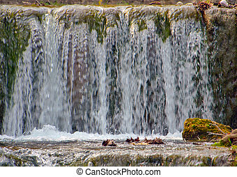 small mountain waterfall in natural