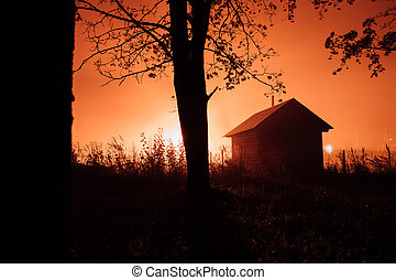 small mysterious house in the autumn foggy forest.
