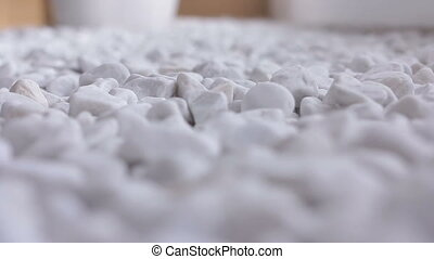 Small naturally polished white rock pebbles