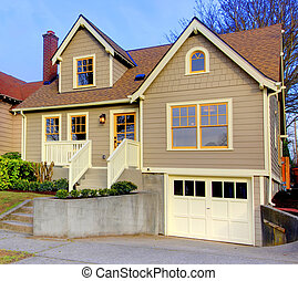 Small new cute brown house with orange doors and windows. -...