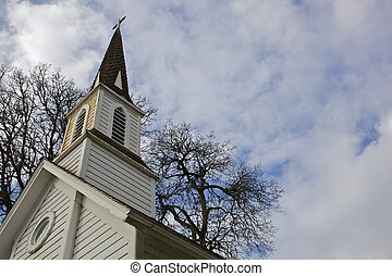 Small old Chruch steeple tree sky - Angled shot of Small old...