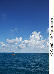 Small old fishing boat in the ocean