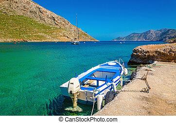 Small open-deck motor boat in Greek colors, Greece
