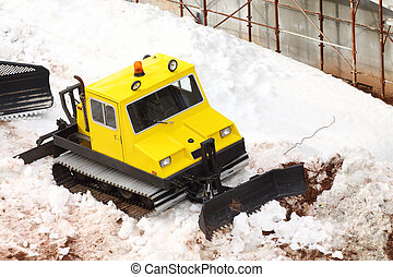 small parked snowcat