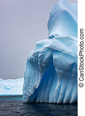 Small part of the blue larger iceberg in ocean, Antarctica