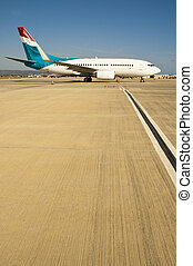 Small passenger airplane queuing on runway for takeoff