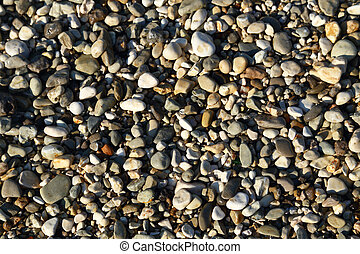 Small pebbles textured macro background