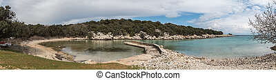 small pier in a bay on the island of Cres