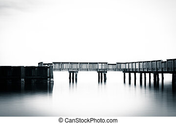 Small pier in the Patapsco River, at Fort Armistead Park, in...