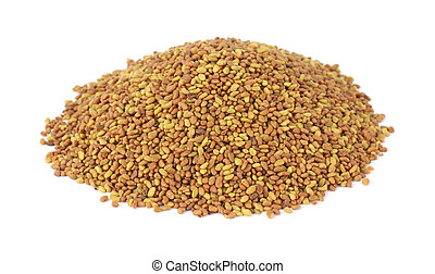 A small mound of alfalfa seeds on a white background.