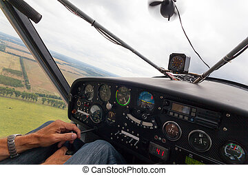 Small plane in flight - View from the cockpit of a light...