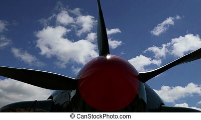 Small plane propeller closeup against sky