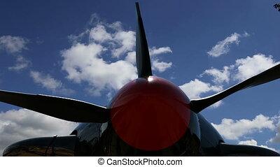 Small plane propeller closeup against sky