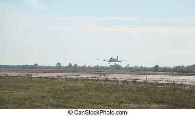 Small plane takes off from the abandoned airfield.