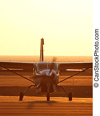 small plane taxing after landing