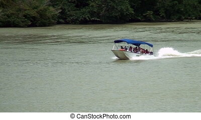 Small pleasure boat on Gatun Lake - Panama Canal - High...