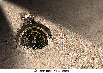 Small Pocket watch in the Sand